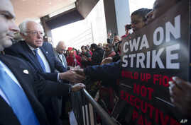 Democratic presidential candidate, Sen. Bernie Sanders, I-Vt., greets a CWA worker at  a Verizon workers picket line, April 13, 2016, in the Brooklyn borough of New York.