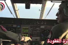 An Egyptian plane searches in the Mediterranean Sea for the missing EgyptAir flight 804 plane, which crashed after disappearing from the radar early Thursday while carrying 66 passengers and crew from Paris to Cairo, in video image released May 19, 2