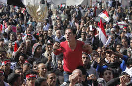 An Egyptian protester shouts anti-government slogans during a protest in Tahrir Square in Cairo, Egypt, February 8, 2013.