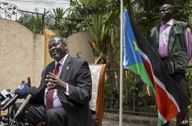 South Sudan's rebel leader Riek Machar, left, speaks to the media about the situation in South Sudan following last week's peace agreement with the government, in Addis Ababa, Ethiopia, Monday, Aug. 31, 2015.