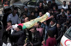 Relatives carry the body of farmer Amero Samor, 27, during his funeral, in front of his family house in Khan Younis, Gaza Strip, March 30, 2018.