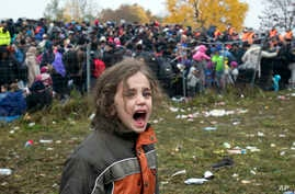 A girl cries as hundreds of migrants wait to cross into Austria from Sentilj, Slovenia, Oct. 29, 2015. In the chaos of migration, children are especially vulnerable to predators. In Germany, a suspect in the death of one boy has confessed to a second...