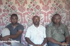 A still image taken from a video released by suspected Boko Haram militants on July 29, 2017, shows three kidnapped members of an oil exploration team in northeastern Nigeria.