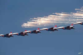 MiG-29 jet fighters of Russian aerobatic team Strizhi (Swifts) perform during a ceremony in Batajnica, military airport near Belgrade, Oct. 20, 2017.
