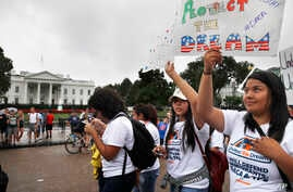 FILE - Daisy Leon, 26, right, of Perth Amboy, N.J., and a recipient of the Deferred Action for Childhood Arrivals program, attends a rally at the White House in Washington, Aug. 15, 2017, along with others in favor of DACA and immigration reform.