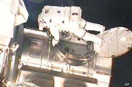 STS-131 Mission Specialist Rick Mastracchio exits the Quest airlock to begin the first of three spacewalks.
