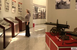 Tamara Elbuzdukaeva, deputy director of the National Museum of the Chechen Republic, is seen in one of the facility's exhibit rooms, in Grozny, Chechnya.