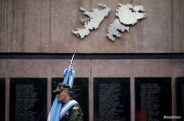 FILE - Argentine Falkland War veteran Jose Gonzalez pays homage for the Argentine soldiers who died in the 1982 conflict between Britain and Argentina in the Falkland Islands, known to Argentines as 'Malvinas', at the memorial dedicated to them in do