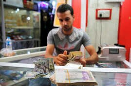 FILE - Iranian rials are seen at a currency exchange shop in Baghdad, Iraq, Aug. 8, 2018.