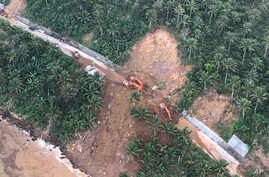 An aerial view of one of several landslides in Camarines Sur province in the Bicol region south of the main island of Luzon, is seen as President Rodrigo Duterte conducts an inspection, Jan. 4, 2019, in the Philippines.