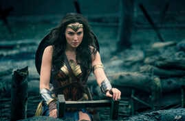 "This image released by Warner Bros. Entertainment shows Gal Gadot in a scene from ""Wonder Woman."" The movie opens June 2 based on the DC Comics character."