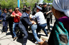 File - Riot police officers detain demonstrators during a protest against President Nursultan Nazarbayev's government and the land reform it has proposed, in Almaty, Kazakhstan, May 21, 2016.