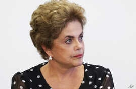 Brazil's President Dilma Rousseff listems in during a meeting at the Planalto Presidential Palace, in Brasilia,  April 13, 2016.