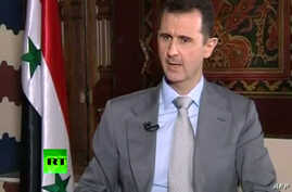 Syrian President Bashar al-Assad during interview with Russian Today in Damascus, Nov. 8, 2012