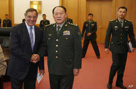 U.S. Defense Secretary Leon Panetta, left, and Chinese Defense Minister Liang Guanglie shake hands before their delegations meet at the Bayi Building in Beijing, China, Sept. 18, 2012