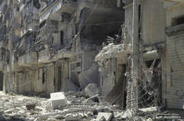 Damaged building are seen in Aleppo's district of Salah Edinne, August 3, 2012.
