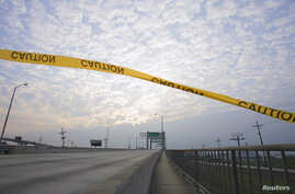Caution tape floats in the wind over a walkway running alongside the Danziger Bridge in eastern New Orleans, Louisiana, Nov. 10, 2005.
