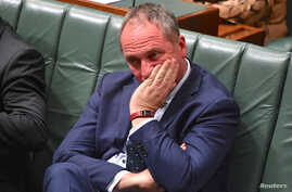 Australian Deputy Prime Minister Barnaby Joyce reacts as he sits in the House of Representatives at Parliament House in Canberra, Australia, Oct. 25, 2017.