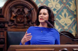 Michigan Gov. Gretchen Whitmer delivers her State of the State address to a joint session of the House and Senate, Feb. 12, 2019, at the state Capitol in Lansing, Michigan.