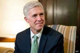 Supreme Court Justice nominee Neil Gorsuch meets with Sen. Chris Coons, D-Del., on Capitol Hill in Washington, Feb. 14, 2017.