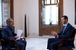 This photo released by the Syrian official news agency SANA, shows Syrian President Bashar Assad speaking during an interview with Iran's Khabar TV, in Damascus, Syria, Sunday, Oct. 4, 2015.
