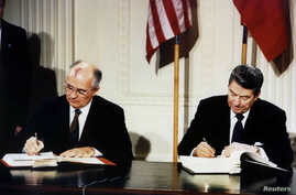 FILE - U.S. President Ronald Reagan (R) and Soviet President Mikhail Gorbachev sign the Intermediate-Range Nuclear Forces (INF) treaty in the White House December 8 1987.