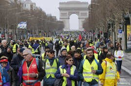"Protesters walk down the Champs-Elysees during a demonstration by the ""yellow vest"" movement in Paris, March 9, 2019."