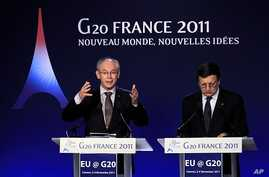 European Council President Herman Van Rompuy (L) gestures as European Commission President Jose Manuel Barroso (R) looks on during a news conference on the second day of the G20 Summit in Cannes November 4, 2011.