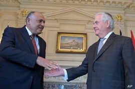 Secretary of State Rex Tillerson, left, shakes hands with Egypt's Minister of Foreign Affairs Sameh Shoukry at the State Department in Washington, Feb. 27, 2017.