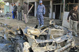 Iraqi security forces inspect the site of the bomb attack in Baghdad's Shaab District - the latest in a series of explosions that rocked Baghdad this day - in northern Baghdad, Iraq, December 22, 2011.