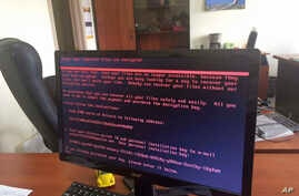 A computer screen cyberattack warning notice reportedly holding computer files to ransom, as part of a massive international cyberattack, at an office in Kiev, Ukraine, Tuesday June 27, 2017,   A new and highly virulent outbreak of malicious data-scr...