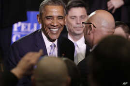 President Barack Obama greets audience members after speaking at Pellissippi State Community College in Knoxville, Tenn., Jan. 9, 2015.