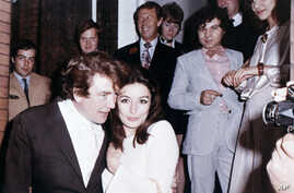 """FILE  - In this 1970 file photo, British actor Albert Finney embraces his bride, French Actress Anouk Aimee, after their registry office wedding in London. Finney, the Academy Award-nominated star of films from """"Tom Jones"""" to """"Skyfall"""" has died at th"""