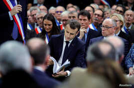 "French President Emmanuel Macron attends a meeting with mayors from rural Normandy as part of the launching of the ""Great National Debate"" designed to find ways to calm social unrest in the country, in Grand Bourgtheroulde, France, Jan. 15, 2019."