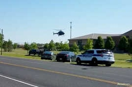 A helicopter lands near Noblesville West Middle School in Noblesville, Indiana, May 25, 2018 in this still image obtained from social media video. Officials say  the shooting suspect asked to be excused from class before returning with the two handgu