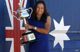 China's Li Na poses for photos at Brighton Beach with her Australian Open trophy following her win over Slovakia's Dominika Cibulkova in Melbourne, Australia, Jan. 26, 2014.