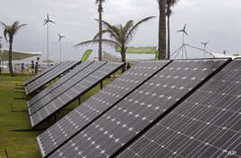 Solar panels are used to generate electricity at the Greenpeace exhibit during the climate change conference in Durban, South Africa, Tuesday, Nov 29, 2011.