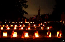 Luminaries mark the graves of Union dead at Soldiers' National Cemetery during ongoing activities commemorating the 150th anniversary of the Battle of Gettysburg, June 30, 2013.