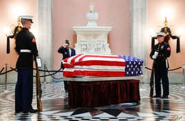 Marines stand guard at the casket of John Glenn as he lies in repose inside Ohio's Statehouse rotunda in Columbus, Dec. 16, 2016. Glenn, 95, the first American to orbit Earth, died last week.