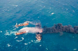 FILE - Firefighting boats work to put on a blaze on the oil tanker Sanchi in the East China Sea off the eastern coast of China, Jan. 10,2018.