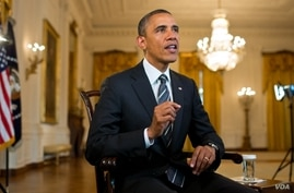 U.S. President Barack Obama tapes the weekly address, August 23, 2012.