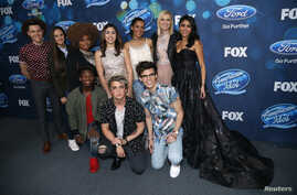 """Finalists (L-R standing) Trent Harmon, Avalon Young, La'Porsha Renae, Gianna Isabella, Tristan McIntosh, Olivia Rox, Sonika Vaid, (L-R front) Lee Jean, Dalton Rapattoni and MacKenzie Bourg pose at the party for the finalists of """"American Idol XV"""" in"""