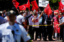 A group of pro-Erdogan demonstrators shout slogans at a group of anti-Erdogan Kurds in Lafayette Park as Turkey's President Tayyip Erdogan met with U.S. President Donald Trump nearby at the White House in Washington, May 16, 2017.