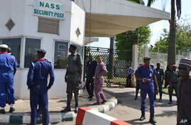 Security men stand guard at the parliament gate in Abuja, Nigeria. Thursday, Nov. 20, 2014.
