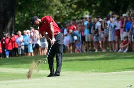 Tiger Woods hits from the fifth fairway during the final round of the Tour Championship golf tournament Sunday, Sept. 23, 2018, in Atlanta.