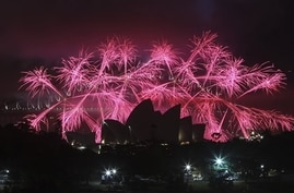 Fireworks explode behind Sydney's Opera House during New Year's celebrations, Australia, Dec. 31, 2013.