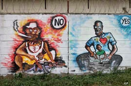 """In this photo taken Sunday, Nov. 6, 2016, a mural painted by the Ana Taban, or """"I am tired"""" artists movement, depicting South Sudanese families, is seen in Juba, South Sudan.   For many in South Sudan, the arts have become a rare haven of peace in a"""