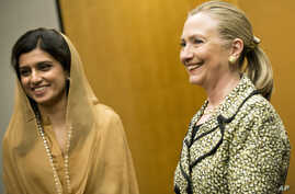 US Secretary of State Hillary Rodham Clinton and Pakistan Foreign Minister Hina Rabbani Khar before a bilateral meeting at a hotel in Tokyo , Japan, July 8, 2012