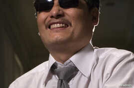 Blind Chinese activist Chen Guangcheng, who flew to the United States last week, said China's handling of the local officials who harassed and abused him and his family will determine whether the country can begin to achieve rule of law, May 24, 2012