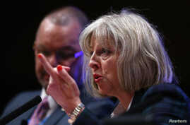 FILE - Britain's Home Secretary Theresa May said a panel of legal and child-protection experts would investigate how public agencies handle child-abuse allegations July 7, 2014. She's shown at a conference in Bournemouth, England, May 21, 2014.
